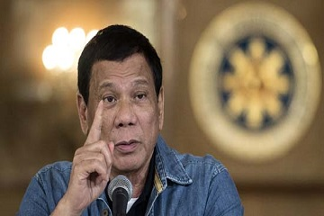 "Philippine's President Rodrigo Duterte gestures as he answers a question during a press conference at the Malacanang palace in Manila on January 30, 2017.  Philippine's President Rodrigo Duterte on January 30, 2017 extended his deadly drug war until the last day of his term in 2022, but conceded the police force acting as his frontline troops was ""corrupt to the core"". Thousands of people have died in the crackdown that began when Duterte took office in the middle of last year, with rights groups warning police are carrying out extrajudicial killings not just to fight crime but to aid their own corrupt activities. / AFP PHOTO / POOL / NOEL CELIS"